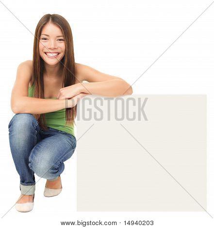 Woman Sitting Showing Billboard Sign