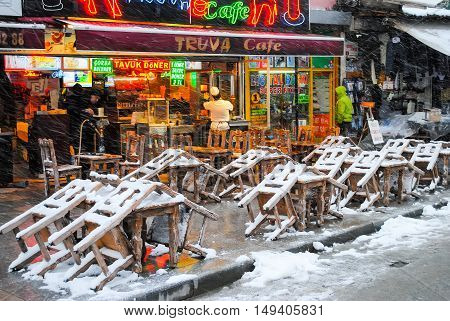 ISTANBUL THE CENTRAL MARKET - JANUARY 7/2016: Traders on the Istanbul market selling a variety of goods during a snowfall.