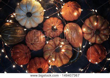 Halloween pumpkins with electric illumination on a dark background