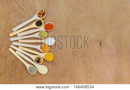 Various kind of spices in wooden bowls salt pepper garlic spice turmeric