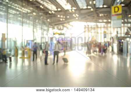 Blured Shot of Check in Counter and Passengers in a airport departure terminal.