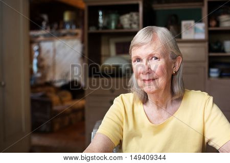 Grinning Woman In Yellow Shirt