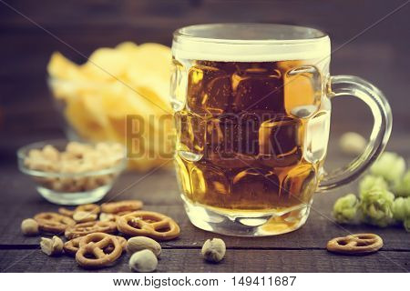 Beer And Snacks Set: Chips, Pistachio, Pretzel, And Nuts  On Bla