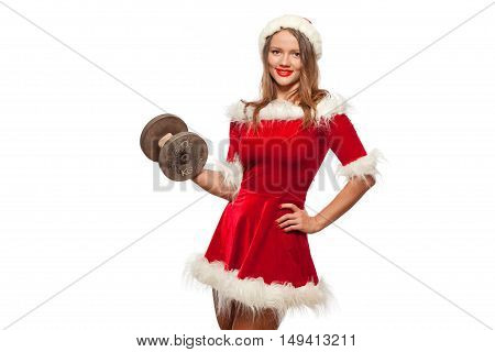 christmas, x-mas, winter, happiness concept - Bodybuilding. Strong fit woman exercising with dumbbells in santa helper hat , isolated on White Background. Muscular blonde girl lifting weights studio shot.