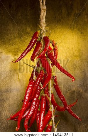 Bunch of red chili peppers on a wooden background