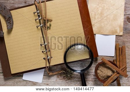 Cinnamon and note pad on an old wooden table