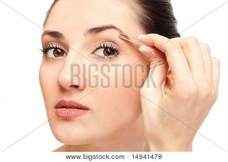 Woman Plucking Eyebrow Tweezers