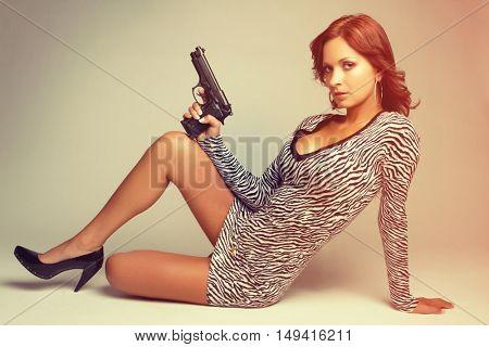 Sexy latin woman holding gun