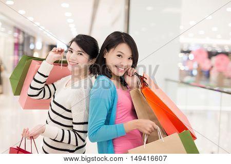 Happy women shopping in the mall, hong kong, asian