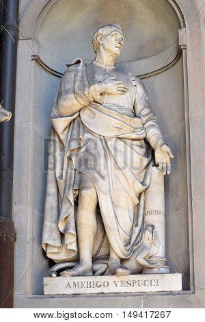 FLORENCE, ITALY - January 20, 2016: Amerigo Vespucci ( italian florentine explorer, financier, navigator and cartographer ) statue by Gaetano Grazzini on facade of Uffizi Gallery, Florence, Italy