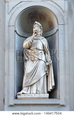 FLORENCE, ITALY - January 20, 2016: Francesco Petrarca or Petrarch ( italian florentine poet and early humanist ) statue on facade of Uffizi Gallery, Florence, Italy