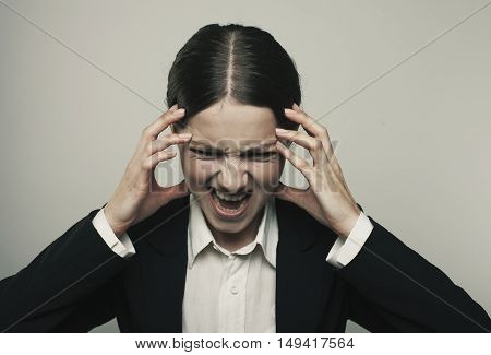 Stress Woman Stressed Is Going Crazy Pulling Her Hair In Frustration Close Up Of Young Businesswoman