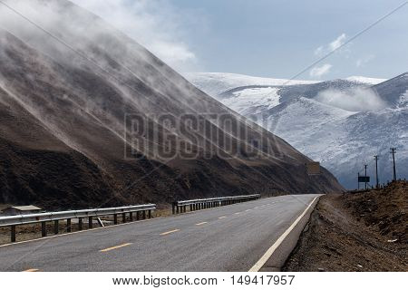Beautiful winter road in Tibet under snow mountain Sichuan China
