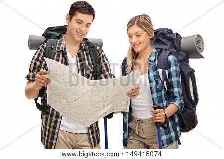 Young hikers looking at a generic map isolated on white background