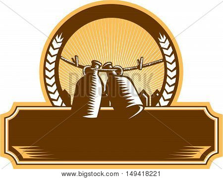 Illustration of a growler a glass ceramic or stainless steel jug used to transport draft beer in the United States hanging on a clothesline set inside circle with picket fence and sunburst in the background done in retro woodcut style.
