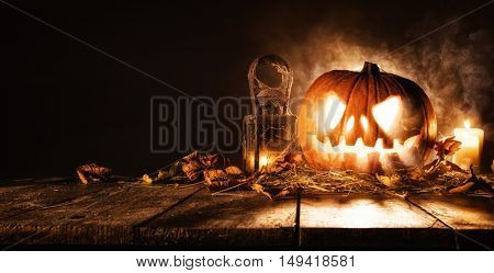 Scary halloween pumpkin on wooden planks. Empty space for text