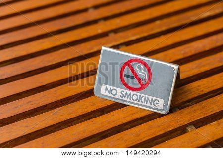 NO Smoking sign on wood table