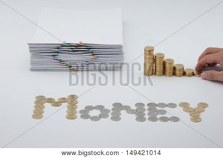 Hand Putting Step Pile Of Gold Coins