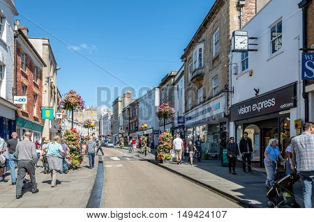 Wells UK - August 15 2015: High Street. Commercial street in city center. Wells is a Cathedral City in Somerset.