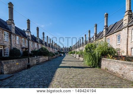 Wells UK - August 15 2015: Vicars Close is claimed to be the oldest purely residential street with original buildings surviving intact in Europe. Blue sky day.