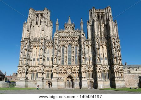 Wells UK - August 15 2015: Outdoors of Wells Cathedral. It is an Anglican cathedral dedicated to St Andrew the Apostle in Gothic and Early English Style
