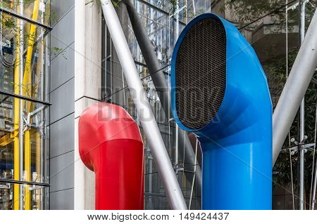 LONDON UK - AUGUST 21 2015: Detail of colorful ventilation funnels of 88 Wood Street building - It was designed by the architect Richard Rogers.