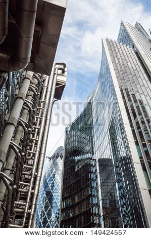 LONDON UK - AUGUST 21 2015: Low angle view of some buildings in the City of London: Lloyds Willis and Gherkin Tower