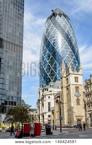 LONDON UK - AUGUST 21 2015: Street view in the City of London with Gherkin Tower