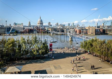 LONDON UK - AUGUST 22 2015: High angle view of London with Millennium bridge Thames waterfront and St Pauls Church a sunny day.