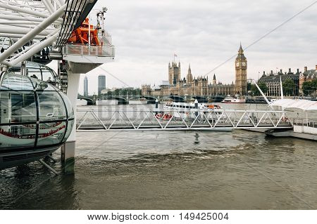 LONDON UK - AUGUST 23 2015: London cloudy morning. London eye Westminster Bridge Big Ben and Houses of Parliament.