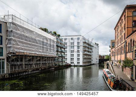 LONDON UK - AUGUST 20 2015: Regent Canal near Camden Town Market famous alternative culture shops. Cloudy day