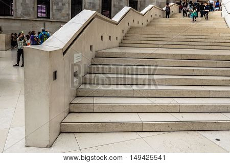 LONDON UK - AUGUST 20 2015: British Museum main court stairs. The British Museum in London is dedicated to human history and culture.