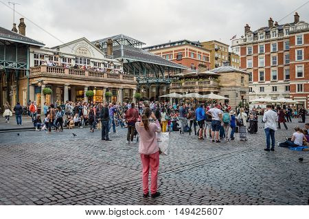 LONDON UK - AUGUST 20 2015: View of Covent Garden market a tourist attraction in London known as restaurants pubs shops and public performing.