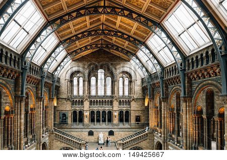 London UK - August 19 2015: Main hall of famous London Natural History Museum with tourists visitors