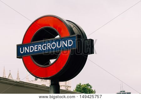 London UK - August 18 2015: London underground sign near Westminster station. The London Underground logo or 'roundel' is one of the most recognised British icons and is seen just about everywhere in London.
