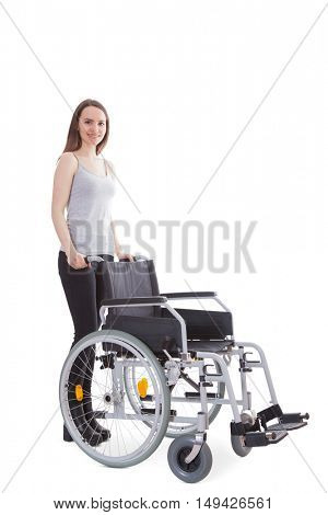 Woman pushing wheelchair. All on white background