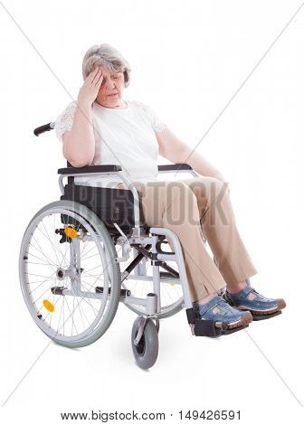 Invalid senior sitting in wheelchair. All on white background.