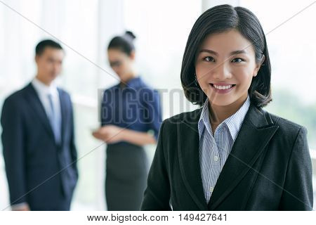 Portrait of Vietnamese young business lady looking at camera