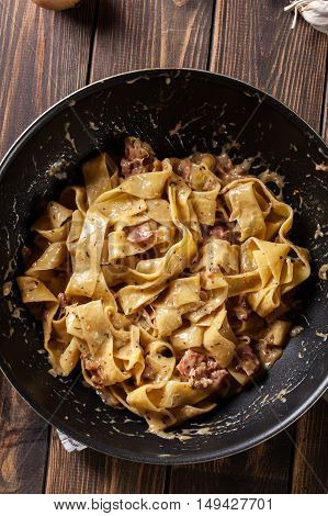 Pappardelle Pasta With Prosciutto And Cheese Sauce On Pan
