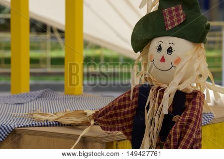 scarecrow in the garden, a toy of hay to scare away crows