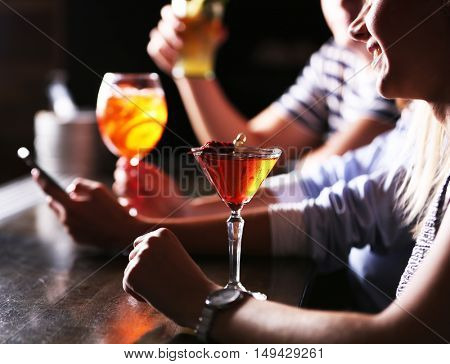 Friends with cocktails in bar