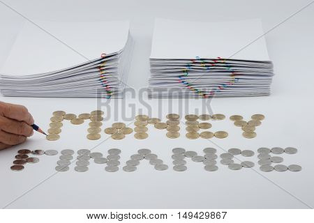 Pencil In Man's Hand With Coins And Document