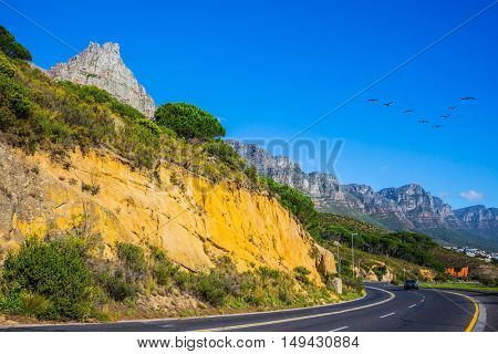Scenic highway on the Cape of Good Hope in the Atlantic. Travel to South Africa. The concept of active tourism