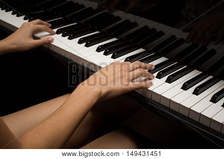 a woman playing a piano, a music photo