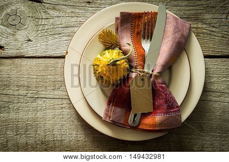 Thanksgiving table setting with decorations, copy space