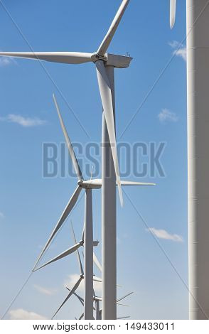 Wind turbines and blue sky. Clean alternative renewable energy. Vertical
