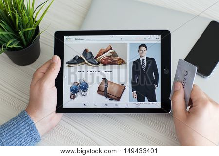 Alushta Russia - September 23 2016: Man holding a iPad Pro with Internet shopping service Amazon on the screen. iPad Pro 9.7 Space Gray was created and developed by the Apple inc.