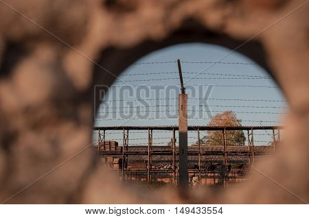 Look through the wall of the prison