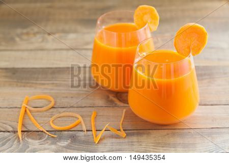 Carrot Juice In Glass On  Table
