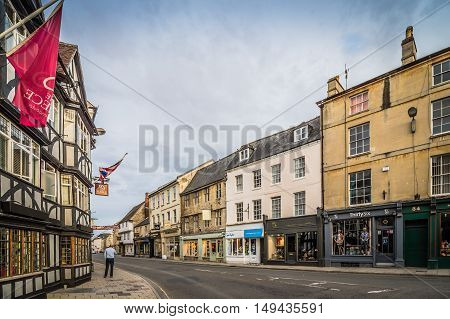 CIRENCESTER UK - AUGUST 11 2015: Town of Cirencester at sunset. Cirencester is a market town in the Cotswolds.